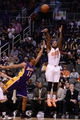 Jan 15, 2014; Phoenix, AZ, USA; Phoenix Suns forward P.J. Tucker (17) shoots the ball over Los Angeles Lakers guard Wesley Johnson (11) in the second half at US Airways Center. The Suns won 121-114. Mandatory Credit: Jennifer Stewart-USA TODAY Sports