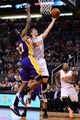 Jan 15, 2014; Phoenix, AZ, USA; Phoenix Suns guard Goran Dragic (1) shoots the ball as Los Angeles Lakers center Jordan Hill (27) defends in the second half at US Airways Center. The Suns won 121-114. Mandatory Credit: Jennifer Stewart-USA TODAY Sports