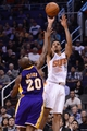 Jan 15, 2014; Phoenix, AZ, USA; Phoenix Suns guard Gerald Green (14) shoots the ball over Los Angeles Lakers guard Jodie Meeks (20) in the second half at US Airways Center. The Suns won 121-114. Mandatory Credit: Jennifer Stewart-USA TODAY Sports