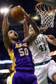 Jan 17, 2014; Boston, MA, USA; Los Angeles Lakers center Robert Sacre (50) grabs the rebound against Boston Celtics center Kelly Olynyk (41) in the second half at TD Garden. The Los Angeles Lakers defeated the Celtics 107-104. Mandatory Credit: David Butler II-USA TODAY Sports