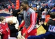 Jan 18, 2014; Washington, DC, USA; Washington Wizards guard John Wall (center) high fives fans prior to the game against the Detroit Pistons at Verizon Center. Mandatory Credit: Evan Habeeb-USA TODAY Sports