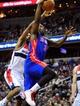 Jan 18, 2014; Washington, DC, USA; Detroit Pistons guard Rodney Stuckey (3) lays the ball up over Washington Wizards forward Trevor Ariza (1) at Verizon Center. Mandatory Credit: Evan Habeeb-USA TODAY Sports