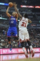 Jan 18, 2014; Chicago, IL, USA;  Philadelphia 76ers small forward Evan Turner (12) is defended by Chicago Bulls shooting guard Jimmy Butler (21) during the first quarter at the United Center. Mandatory Credit: David Banks-USA TODAY Sports