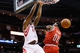 Jan 18, 2014; Houston, TX, USA; Houston Rockets forward Terrence Jones (6) dunks over Milwaukee Bucks guard O.J. Mayo (0) during the first half at Toyota Center. Mandatory Credit: Soobum Im-USA TODAY Sports