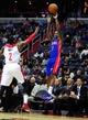 Jan 18, 2014; Washington, DC, USA; Detroit Pistons guard Brandon Jennings (7) shoots the ball over Washington Wizards guard John Wall (2) at Verizon Center. Mandatory Credit: Evan Habeeb-USA TODAY Sports