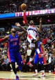 Jan 18, 2014; Washington, DC, USA; Washington Wizards guard John Wall (2) shoots the ball over Detroit Pistons forward Greg Monroe (10) at Verizon Center. Mandatory Credit: Evan Habeeb-USA TODAY Sports