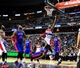 Jan 18, 2014; Washington, DC, USA; Washington Wizards guard John Wall (2) lays the ball up over Detroit Pistons guard Rodney Stuckey (3) at Verizon Center. Mandatory Credit: Evan Habeeb-USA TODAY Sports