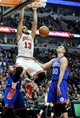 Jan 18, 2014; Chicago, IL, USA;  Chicago Bulls center Joakim Noah (13) dunks as Philadelphia 76ers center Spencer Hawes (00) watches during the second half at the United Center. The Chicago Bulls defeated the Philadelphia 76ers 103-78. Mandatory Credit: David Banks-USA TODAY Sports