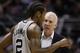 Jan 19, 2014; San Antonio, TX, USA; San Antonio Spurs head coach Gregg Popovich talks to Kawhi Leonard (2) during the first half against the Milwaukee Bucks at AT&T Center. Mandatory Credit: Soobum Im-USA TODAY Sports