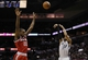 Jan 19, 2014; San Antonio, TX, USA; San Antonio Spurs guard Patrick Mills (8) shoots against Milwaukee Bucks forward Khris Middleton (22) during the first half at AT&T Center. Mandatory Credit: Soobum Im-USA TODAY Sports
