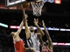 Jan 19, 2014; San Antonio, TX, USA; San Antonio Spurs forward Tim Duncan (21) drives to the basket as Milwaukee Bucks guard Giannis Antetokounmpo (left) and center Larry Sanders (right) defend during the first half at AT&T Center. Mandatory Credit: Soobum Im-USA TODAY Sports