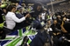 Jan 19, 2014; Seattle, WA, USA; Seattle Seahawks cornerback Richard Sherman (25) leaps back to the field after celebrating with fans after the 2013 NFC Championship football game against the San Francisco 49ers at CenturyLink Field. Mandatory Credit: Joe Nicholson-USA TODAY Sports
