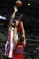 Jan 20, 2014; Auburn Hills, MI, USA; Detroit Pistons center Andre Drummond (0) takes a shot over Los Angeles Clippers power forward Blake Griffin (32) during the third quarter at The Palace of Auburn Hills. Clippers beat the Pistons 112-103. Mandatory Credit: Raj Mehta-USA TODAY Sports