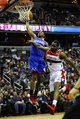 Jan 20, 2014; Washington, DC, USA; Philadelphia 76ers shooting guard James Anderson (9) is fouled by Washington Wizards small forward Martell Webster (9) during the second half at Verizon Center. The Wizards defeated the 76ers 107 - 99. Mandatory Credit: Brad Mills-USA TODAY Sports