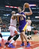 Jan 20, 2014; Chicago, IL, USA; Los Angeles Lakers center Pau Gasol (16) attempts to shoot the ball against Chicago Bulls power forward Carlos Boozer (5) during the first half at United Center. Mandatory Credit: Mike DiNovo-USA TODAY Sports