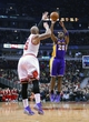 Jan 20, 2014; Chicago, IL, USA; Los Angeles Lakers shooting guard Jodie Meeks (20) shoots the ball against Chicago Bulls power forward Carlos Boozer (5) during the first half at United Center. Mandatory Credit: Mike DiNovo-USA TODAY Sports