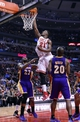 Jan 20, 2014; Chicago, IL, USA; Chicago Bulls shooting guard Jimmy Butler (21) shoots the ball against Los Angeles Lakers power forward Jordan Hill (27) during the second half at United Center. The Bulls defeat the Lakers 102-100 in overtime. Mandatory Credit: Mike DiNovo-USA TODAY Sports