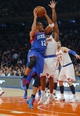 Jan 22, 2014; New York, NY, USA;  Philadelphia 76ers small forward Evan Turner (12) drives to the basket during the first half against New York Knicks point guard Raymond Felton (2) at Madison Square Garden. Mandatory Credit: Jim O'Connor-USA TODAY Sports