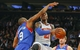 Jan 22, 2014; New York, NY, USA;  Philadelphia 76ers shooting guard James Anderson (9) fouls New York Knicks shooting guard Iman Shumpert (21) as he drives to the basket during the second half at Madison Square Garden. Philadelphia 76ers defeat the New York Knicks 110-105. Mandatory Credit: Jim O'Connor-USA TODAY Sports