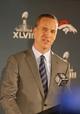 Jan 26, 2014; Jersey City, NJ, USA;  Denver Broncos quarterback Peyton Manning addresses the media during press conference at the Cornucopia Majesty Ship. Mandatory Credit: Jim O'Connor-USA TODAY Sports