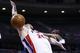 Jan 28, 2014; Auburn Hills, MI, USA; Detroit Pistons small forward Kyle Singler (25) is fouled by Orlando Magic power forward Kyle O'Quinn (2) in the second half at The Palace of Auburn Hills. Detroit 103-87. Mandatory Credit: Rick Osentoski-USA TODAY Sports