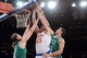 Jan 28, 2014; New York, NY, USA; New York Knicks center Cole Aldrich (45) attempts a layup over Boston Celtics center Kris Humphries (43) and Boston Celtics center Kelly Olynyk (41) during the second half at Madison Square Garden. The New York Knicks won the game 114-88. Mandatory Credit: Joe Camporeale-USA TODAY Sports