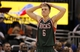 Jan 31, 2014; Orlando, FL, USA; Milwaukee Bucks point guard Nate Wolters (6) reacts from the court against the Orlando Magic during the second half at Amway Center. Orlando Magic won 113-102.  Mandatory Credit: Kim Klement-USA TODAY Sports