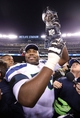 Feb 2, 2014; East Rutherford, NJ, USA; Seattle Seahawks tackle Russell Okung (76) celebrates after winning Super Bowl XLVIII against the Denver Broncos at MetLife Stadium. Seattle Seahawks won 43-8.  Mandatory Credit: Matthew Emmons-USA TODAY Sports