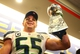 Feb 2, 2014; East Rutherford, NJ, USA; Seattle Seahawks linebacker Heath Farwell holds up the Vince Lombardi Trophy in the locker room after Super Bowl XLVIII against the Denver Broncos at MetLife Stadium.  Mandatory Credit: Mark J. Rebilas-USA TODAY Sports