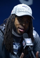 Feb 2, 2014; East Rutherford, NJ, USA; Seattle Seahawks cornerback Richard Sherman is interviewed after Super Bowl XLVIII against the Denver Broncos at MetLife Stadium.  Mandatory Credit: Kirby Lee-USA TODAY Sports