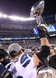 Feb 2, 2014; East Rutherford, NJ, USA; Seattle Seahawks tackle Breno Giacomini (68) celebrates as he hoist the Lombardi Trophy against the Denver Broncos at MetLife Stadium. Seattle Seahawks won 43-8. Mandatory Credit: Matthew Emmons-USA TODAY Sports