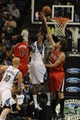 Feb 8, 2014; Minneapolis, MN, USA; Minnesota Timberwolves center Ronny Turiaf (32) shoots over Portland Trail Blazers forward Thomas Robinson (41) in the first quarter at Target Center.  The Trail Blazers defeated the Wolves  117-110.  Mandatory Credit: Marilyn Indahl-USA TODAY Sports