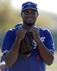 Feb 9, 2014; Glendale, AZ, USA; Los Angeles Dodgers relief pitcher Kenley Jansen (74) smiles during the first day of camp at Camelback Ranch. Mandatory Credit: Rick Scuteri-USA TODAY Sports