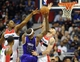Feb 9, 2014; Washington, DC, USA; Sacramento Kings center DeMarcus Cousins (15) shoots as Washington Wizards center Marcin Gortat (4) and Washington Wizards center Kevin Seraphin (left) defend during the first half at Verizon Center. Mandatory Credit: Brad Mills-USA TODAY Sports