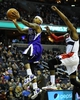 Feb 9, 2014; Washington, DC, USA; Sacramento Kings point guard Isaiah Thomas (22) shoots as Washington Wizards point guard John Wall (2) defends during the second half at Verizon Center. The Wizards defeated the Kings 93 - 84. Mandatory Credit: Brad Mills-USA TODAY Sports