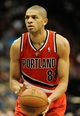 Feb 8, 2014; Minneapolis, MN, USA; Portland Trail Blazers forward Nicolas Batum (88) shoots a free throw in the first half against the Minnesota Timberwolves at Target Center. The Trail Blazers defeated the Wolves  117-110.  Mandatory Credit: Marilyn Indahl-USA TODAY Sports