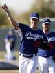 Feb 10, 2014; Glendale, AZ, USA; Los Angeles Dodgers starting pitcher Zack Greinke (21)  during camp at Camelback Ranch. Mandatory Credit: Rick Scuteri-USA TODAY Sports