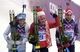 Feb 11, 2014; Krasnaya Polyana, RUSSIA; Darya Domracheva (center) celebrates on the podium as she wins the gold medal along with Tora Berger (left) and Teja Gregorin (right) in the women's biathlon 10k pursuit during the Sochi 2014 Olympic Winter Games at Laura Cross-Country Ski and Biathlon Center. Mandatory Credit: Eric Bolte-USA TODAY Sports
