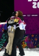 Feb 11, 2014; Krasnaya Polyana, RUSSIA; Iouri Podladtchikov (SUI) (26) receives a hug from Shaun White (USA) left, after winning the gold medal in the mens snowboard half pipe final during the Sochi 2014 Olympic Winter Games at Rosa Khutor Extreme Park. Mandatory Credit: Guy Rhodes-USA TODAY Sports