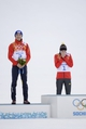 Feb 12, 2014; Krasnaya Polyana, RUSSIA; Akito Watabe (JPN, 2) and Eric Frenzel (GER, 1) at the flower ceremony after the nordic combined competition in the Sochi 2014 Olympic Winter Games at RusSki Gorki Ski Jumping Center. Mandatory Credit: Jack Gruber-USA TODAY Sports