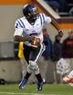 Oct 26, 2013; Blacksburg, VA, USA; Duke Blue Devils quarterback Anthony Boone (7) scrambles with the ball against the Virginia Tech Hokies at Lane Stadium. Mandatory Credit: Peter Casey-USA TODAY Sports