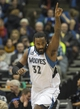 Feb 12, 2014; Minneapolis, MN, USA; Minnesota Timberwolves center Ronny Turiaf (32) points to Minnesota Timberwolves power forward Kevin Love (not pictured) after dunking the ball in the first half against the Denver Nuggets at Target Center. Mandatory Credit: Jesse Johnson-USA TODAY Sports