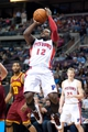 Feb 12, 2014; Auburn Hills, MI, USA; Detroit Pistons point guard Will Bynum (12) during the second quarter against the Cleveland Cavaliers at The Palace of Auburn Hills. Mandatory Credit: Tim Fuller-USA TODAY Sports