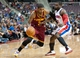 Feb 12, 2014; Auburn Hills, MI, USA; Cleveland Cavaliers point guard Kyrie Irving (2) goes to the basket against Detroit Pistons point guard Will Bynum (12) during the fourth quarter at The Palace of Auburn Hills. Cleveland won 93-89. Mandatory Credit: Tim Fuller-USA TODAY Sports