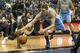 Feb 12, 2014; Minneapolis, MN, USA; Minnesota Timberwolves center Gorgui Dieng (5) and Denver Nuggets center Timofey Mozgov (25) dive for a loose ball in the second half at Target Center. The Timberwolves won 117-90. Mandatory Credit: Jesse Johnson-USA TODAY Sports