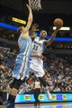 Feb 12, 2014; Minneapolis, MN, USA; Minnesota Timberwolves power forward Dante Cunningham (33) goes up for a shot past Denver Nuggets center Timofey Mozgov (25) in the second half at Target Center. The Timberwolves won 117-90. Mandatory Credit: Jesse Johnson-USA TODAY Sports