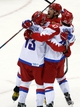Feb 15, 2014; Sochi, RUSSIA; Russia forward Pavel Datsyuk (13) is congratulated by teammates Alex Ovechkin (top) and Alexander Radulov (47) after scoring a goal in the third period against USA in a men's preliminary round ice hockey game during the Sochi 2014 Olympic Winter Games at Bolshoy Ice Dome. Mandatory Credit: Winslow Townson-USA TODAY Sports