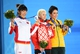 Feb 15, 2014; Sochi, RUSSIA; (Left to right) Mengtao Xu of China, Alla Tsuper of Belarus, and Lydia Lassila of Australia pose for photos during the medal ceremony for Freestyle Skiing Ladies' Aerials during the Sochi 2014 Olympic Winter Games at the Medals Plaza. Mandatory Credit: Robert Deutsch-USA TODAY Sports
