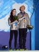 Feb 18, 2014; Sochi, RUSSIA; Meryl Davis (left) and Charlie White (right), of the United States of America, stand for the national anthem after receiving their gold medals during the medal ceremony for Figure Skating Ice Dance during the Sochi 2014 Olympic Winter Games at the Medals Plaza. Mandatory Credit: Jayne Kamin-Oncea-USA TODAY Sports