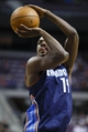 Feb 18, 2014; Auburn Hills, MI, USA; Charlotte Bobcats small forward Michael Kidd-Gilchrist (14) shoots a free throw in the second quarter against the Detroit Pistons at The Palace of Auburn Hills. Mandatory Credit: Rick Osentoski-USA TODAY Sports